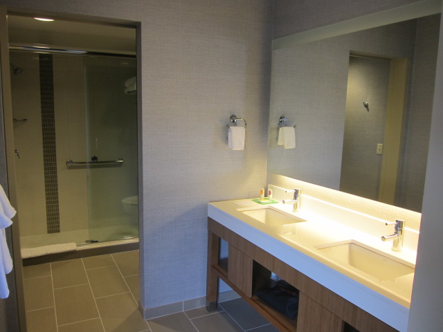 The bathroom is bigger than both of our bathrooms at home combined
