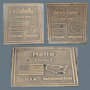 Country Plaques in sidewalk.