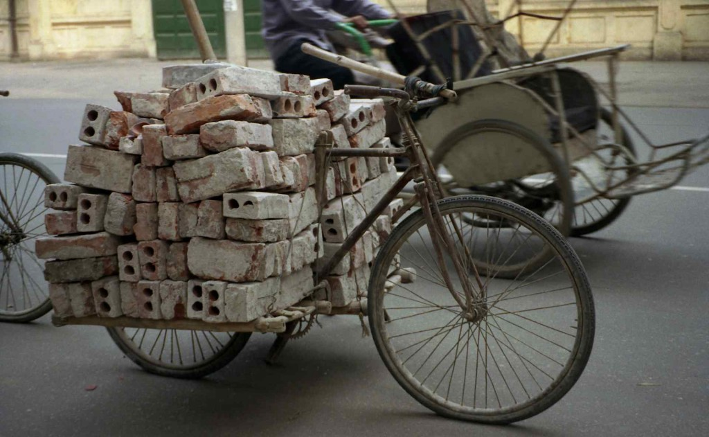 Bicycle carrying bricks; HaNoi, Vietnam