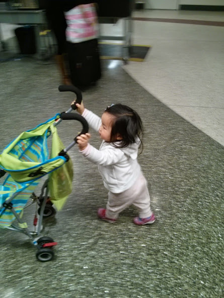Pushing her stroller to gate check