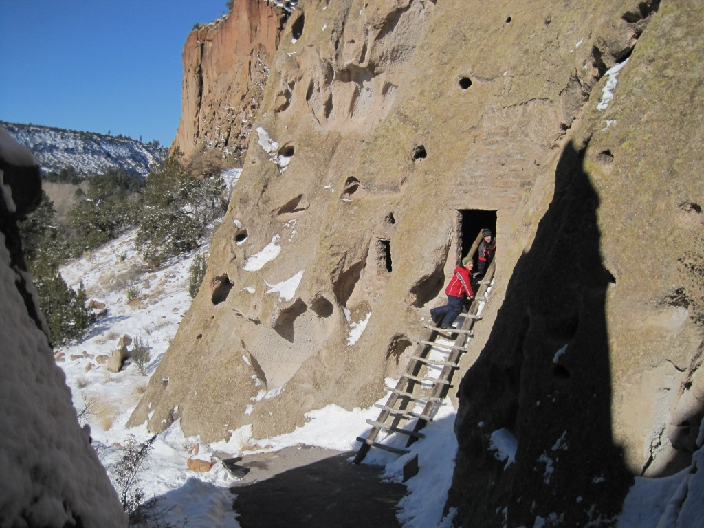 Kids exploring cliffside caves Bandelier National Monument - We had the park to ourselves on Christmas eve!